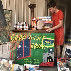 Bookseller Audrey Parks posing with her Good Night Moon inspired sign.