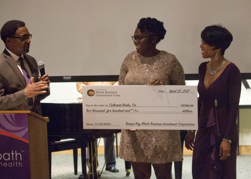Lorielle J. Hollaway receives a grant.