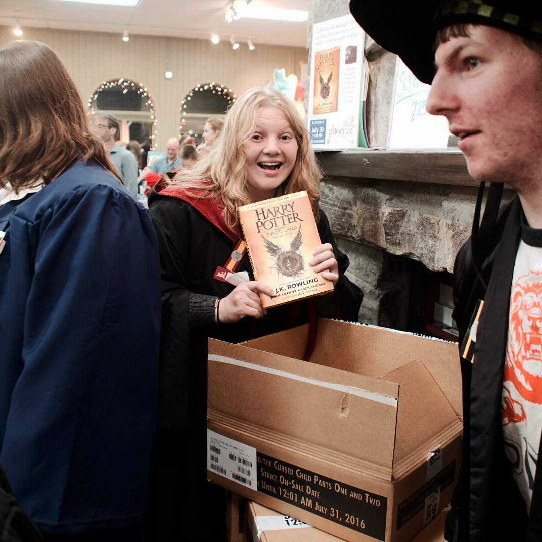 A partygoer at Phoenix Burlington with first copy of new book.