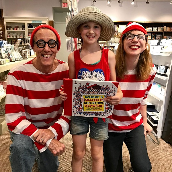A participant posing with two booksellers dressed as Waldo at Hickory Stick Bookshop in Washington Depot, Connecticut.