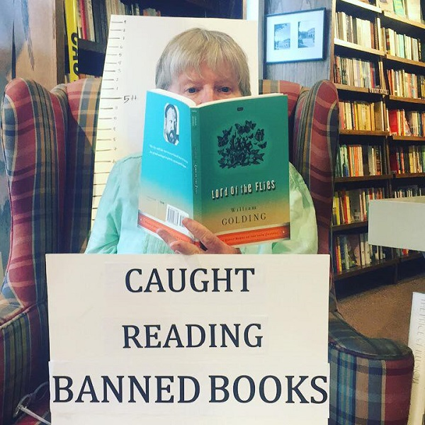 A customer gets caught reading at Hickory Stick Bookshop.