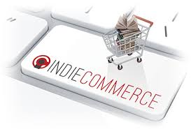 IndieCommerce button on keyboard with shopping cart full of books on top of it
