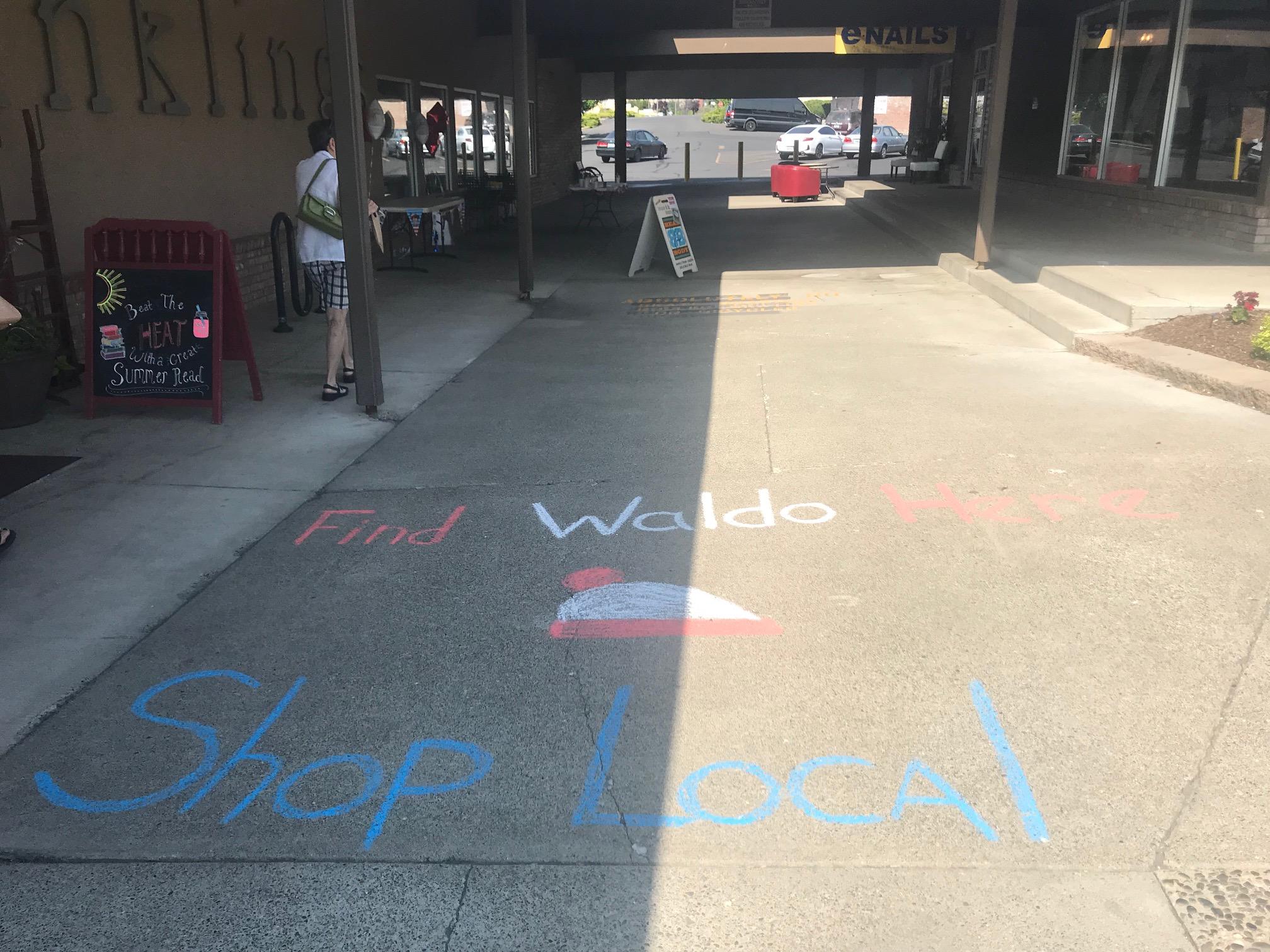 Inklings Bookshop in Yakima, Washington, promoted Find Waldo Local with chalk art.