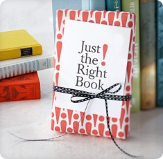 "Photo of a book with a card that says ""Just the right book"""