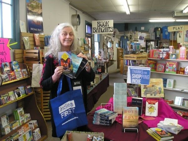 Kathleen Meyer checks out the Thanks for Shopping Indie table at Chapter One Book Store in Hamilton, Montana.