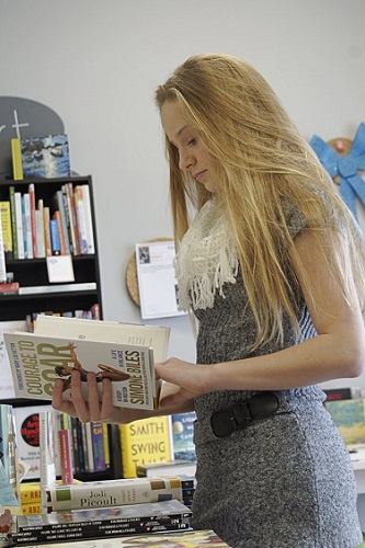 A teenager browsing at Gathering Volumes (photo courtesy of NWOTBF website)