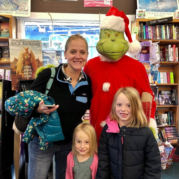 Customers pose with the Grinch at Liberty Bay Books.