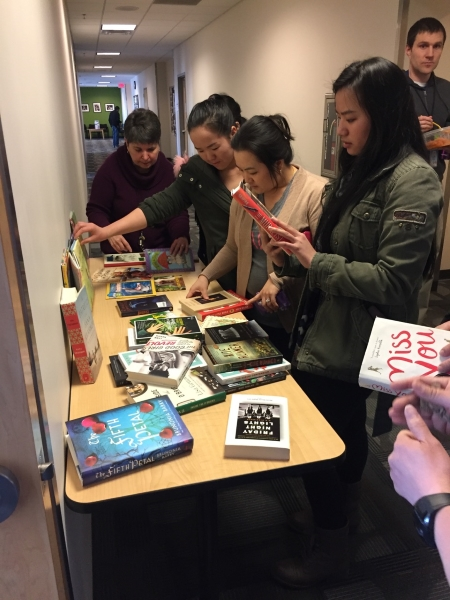 MN adult education students peruse donated titles.