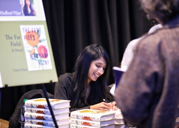 Indies Introduce author Madhuri Vijay signs books at the Author Cocktail Reception.