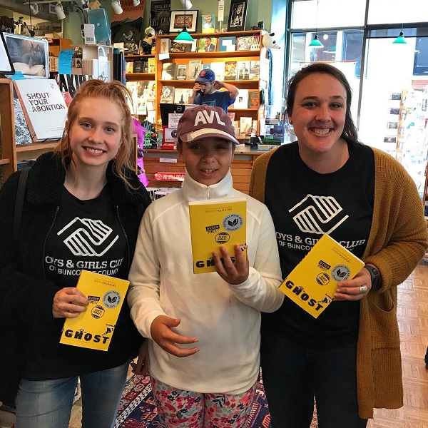 Readers posing with Ghost at Malaprop's Bookstore in Asheville, North Carolina.