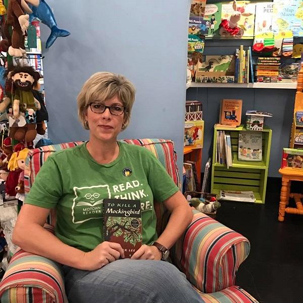 "Midtown Reader owner Sally Bradshaw with ""To Kill a Mockingbird."""