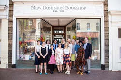 The staff at New Dominion Bookshop celebrating Independent Bookstore Day and their second annual Rose Garden Party.