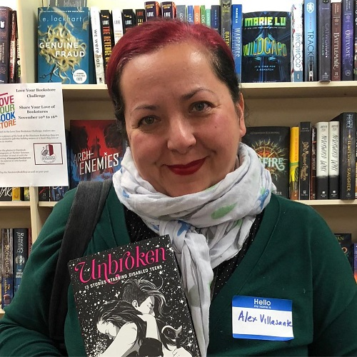 Author Alex Villasante posing with Unbroken, 13 Stories Starring Disabled Teens at Newtown Bookshop