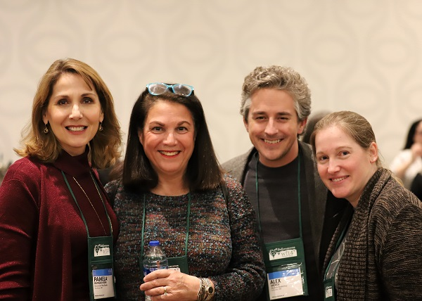 Booksellers pose together at the Wi14 Welcome Reception.