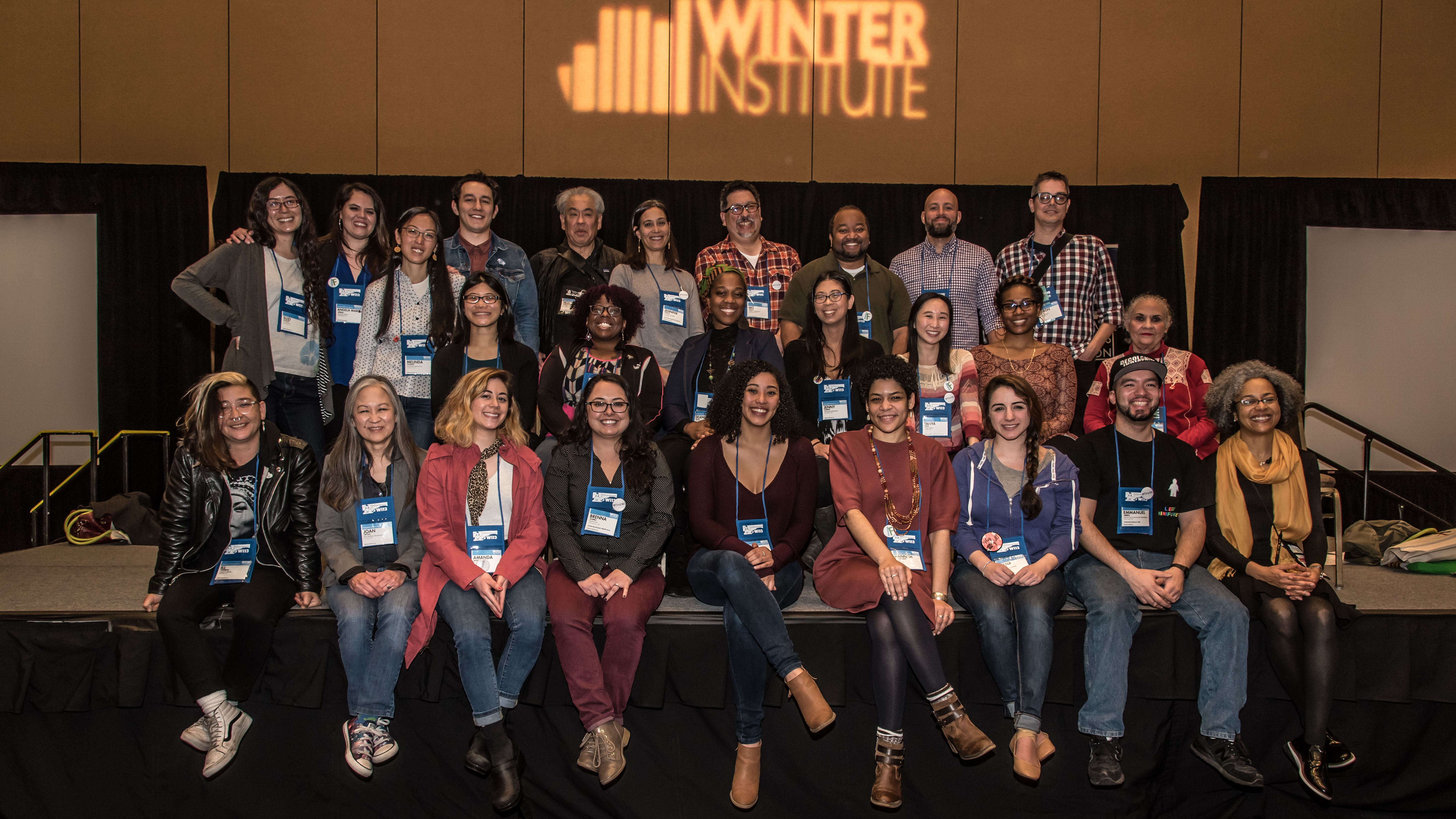 ABA member booksellers posed for a photo celebrating the diversity represented at Wi13.