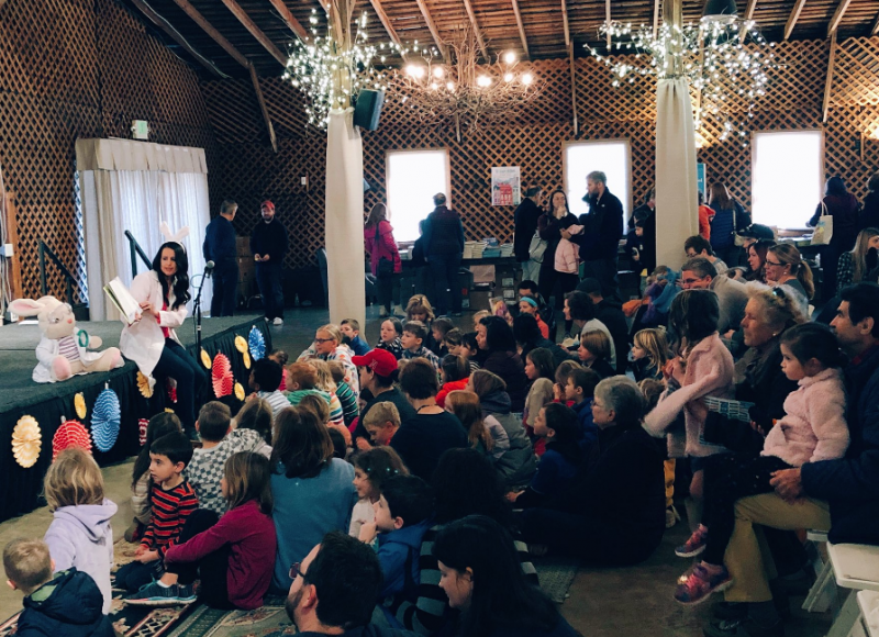 "Camille Andros, author of ""Charlotte the Scientist Is Squished"" (Clarion Books), reads to children at the Whirlikids Book Festival."