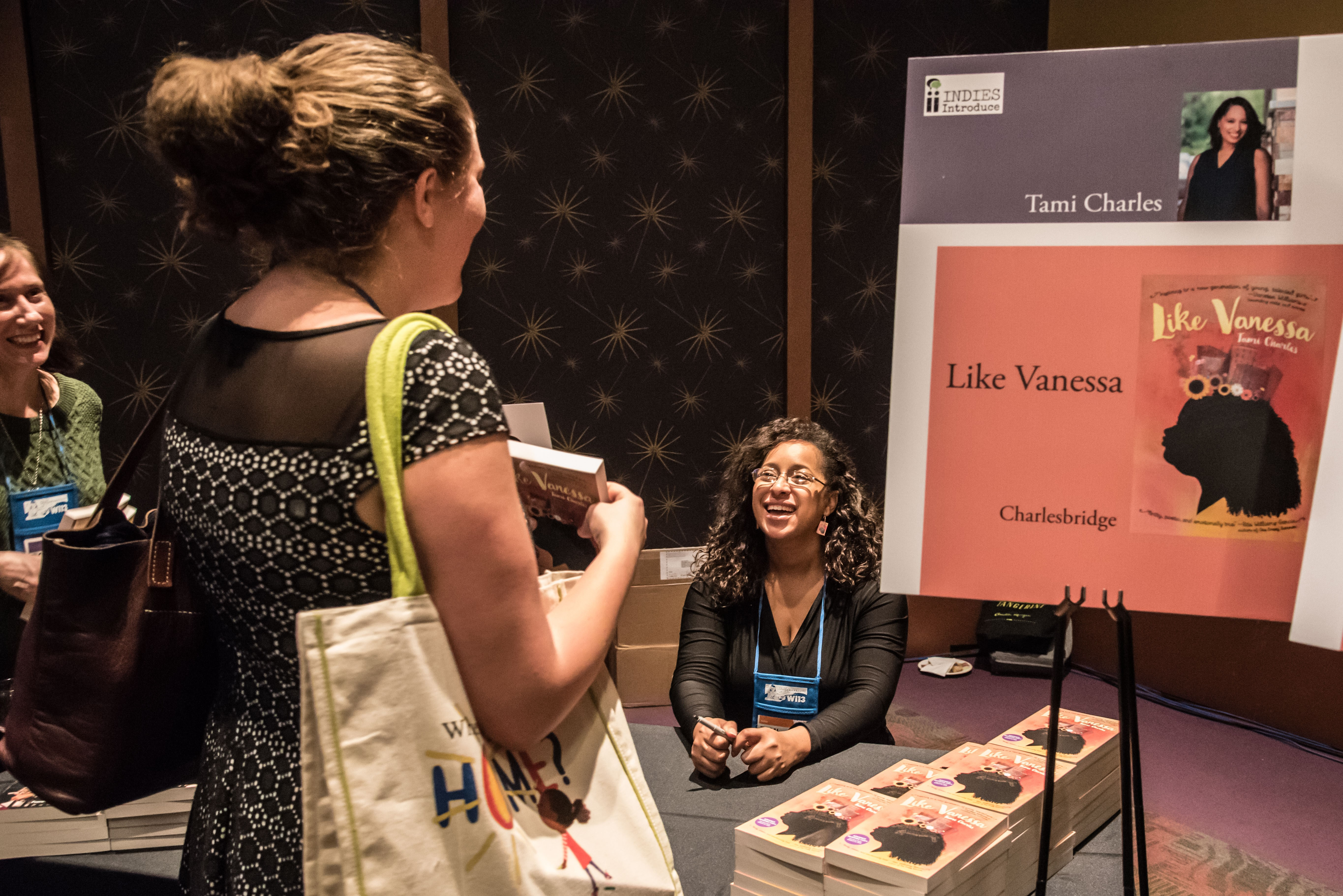 """Tami Charles signs copies of """"Like Vanessa"""" at the Author Reception."""