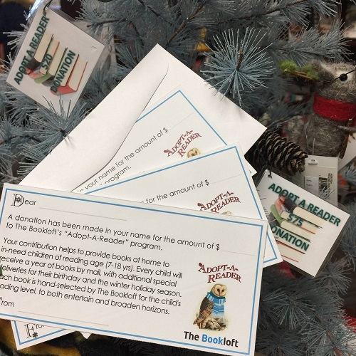 The Adopt-A-Reader informational cards at The Bookloft