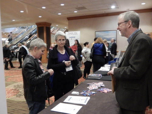 ABFE Director Chris Finan greets a couple of Winter Institute's 40 international guests.