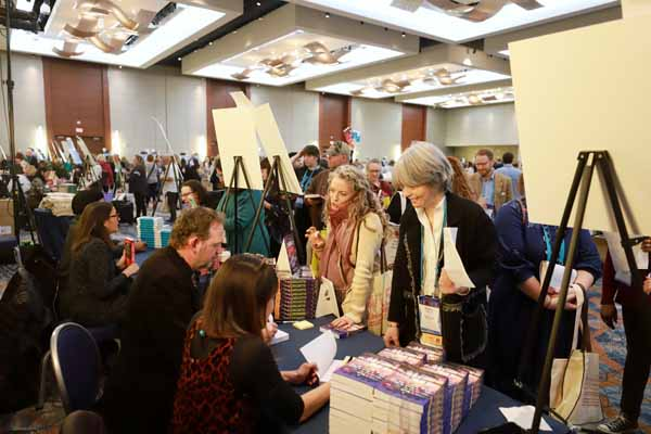 The author reception welcomed hundreds of booksellers to collect galleys and finished books from dozens of authors.