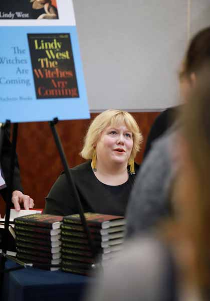 Author Lindy West talks with a bookseller during the author reception.