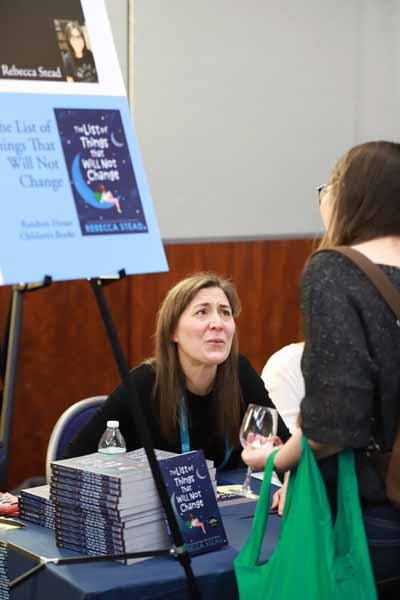 Rebecca Stead talked with a bookseller at the author reception.
