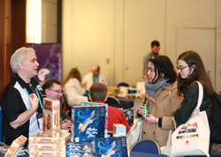 Booksellers perusing board games at Winter Institute