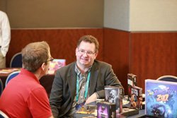 Booksellers talking with board game publishers at Winter Institute