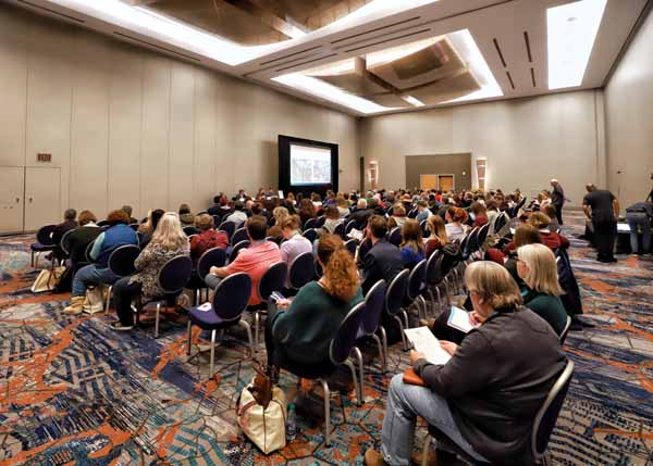 Booksellers learn about buying for small stores in a special education session ahead of the Welcome Reception.