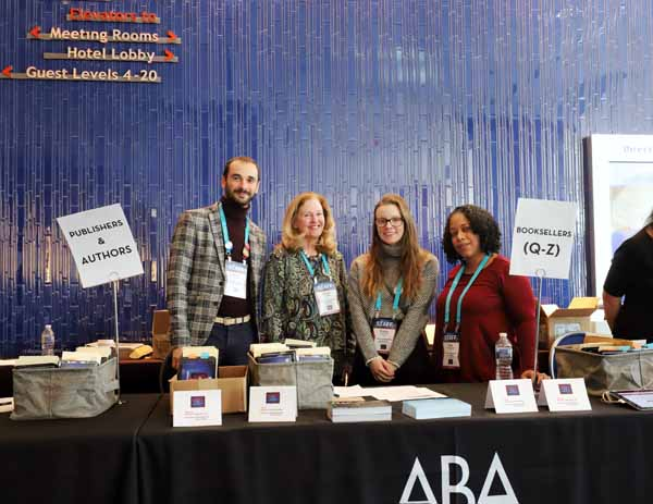 ABA staff prepare to hand out badges and welcome bags to hundreds of Winter Institute attendees.