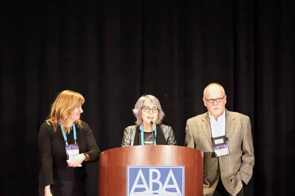 Shelf Awareness's Jen Risko, ABA's Joy Dallanegra-Sanger, and Shelf's John Mutter at the opening reception.