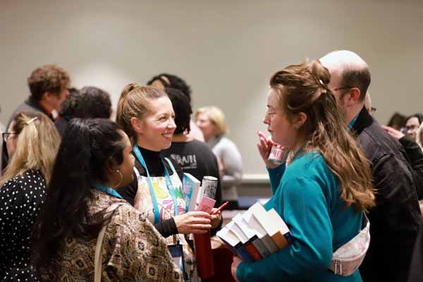Booksellers chat at the Mix & Mingle with Romance Authors, sponsored by HarperCollins.