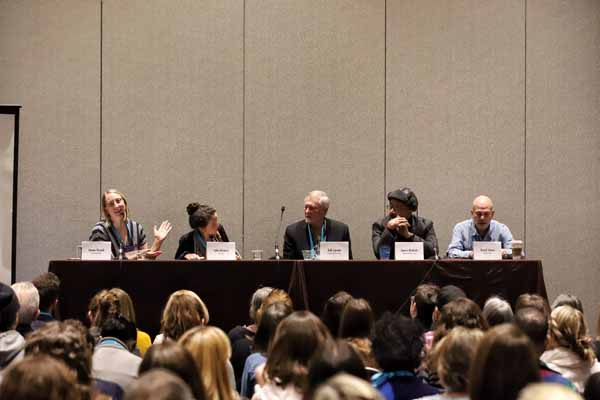 A panel of authors discussed writing in times of crisis for an audience of booksellers.