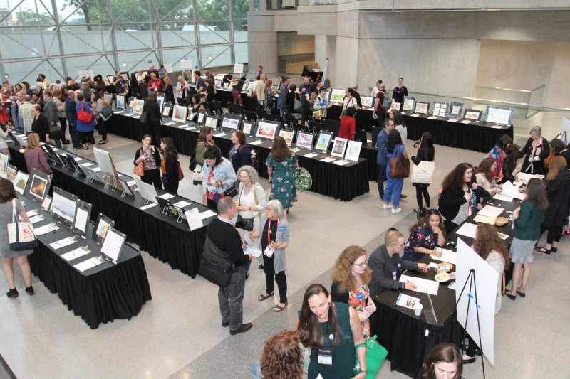 Booksellers, publishers, authors, and illustrators peruse the pieces at the 2019 Silent Art Auction to benefit ABFE and Every Child a Reader.