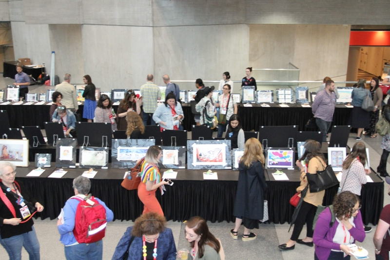 Attendees peruse the artwork at the 2019 Silent Art Auction at BookExpo.