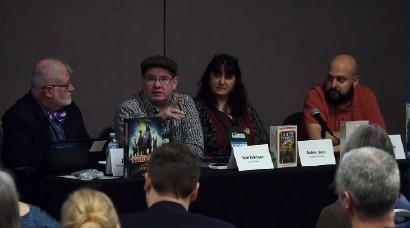 GAMA executive director John Stacy; booksellers Todd Dickinson and Andrea Jones; and indie board game seller Vincent Briseno