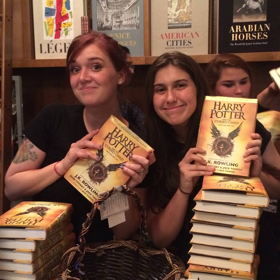 Booksellers at Book & Books with Harry Potter scriptbook.