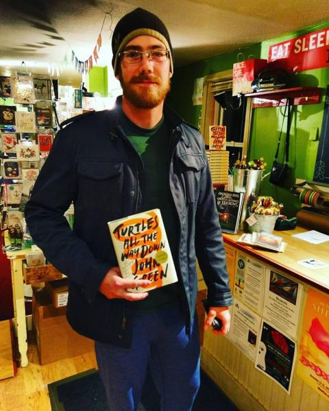 The first customer to pick up a copy of Turtles All the Way Down at Bridgeside Books in Waterbury, Vermont.
