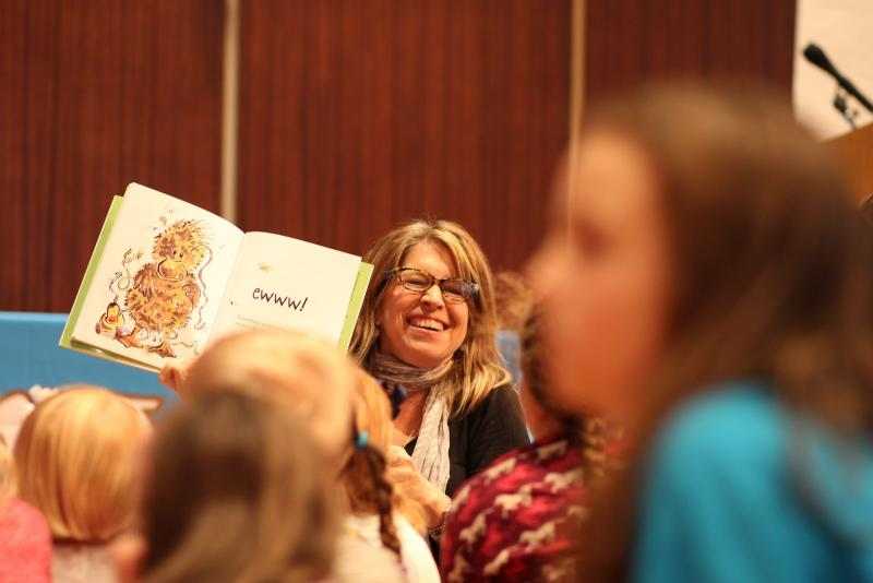 Author Doreen Cronin reads on stage during an interactive break-out sessions at Kleinhans Music Hall at the 2016 Expo.