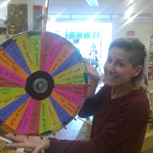 Bookseller Jenn shows off the Lahaska Bookshop's prize wheel at the Lahaska, Pennsylvania, store.