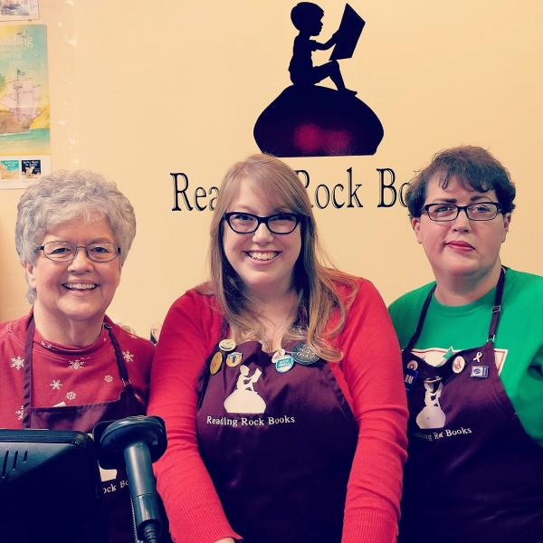 Laura Hill, center, and Amy Jernigan, right, with their mom, Mary Phy, who also works at Reading Rock Books.