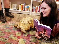 Lindsay Lackey, author of All the Impossible Things, posing with a special guest tortoise.