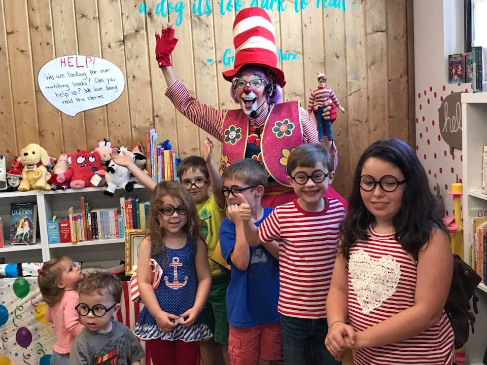Participants at Maggie Mae's Kids Bookshop in Gresham, Oregon, posed with Cha Cha the Clown.