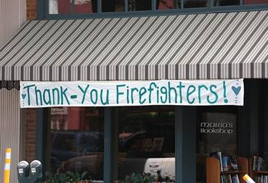 Maria's storefront with firefighters sign