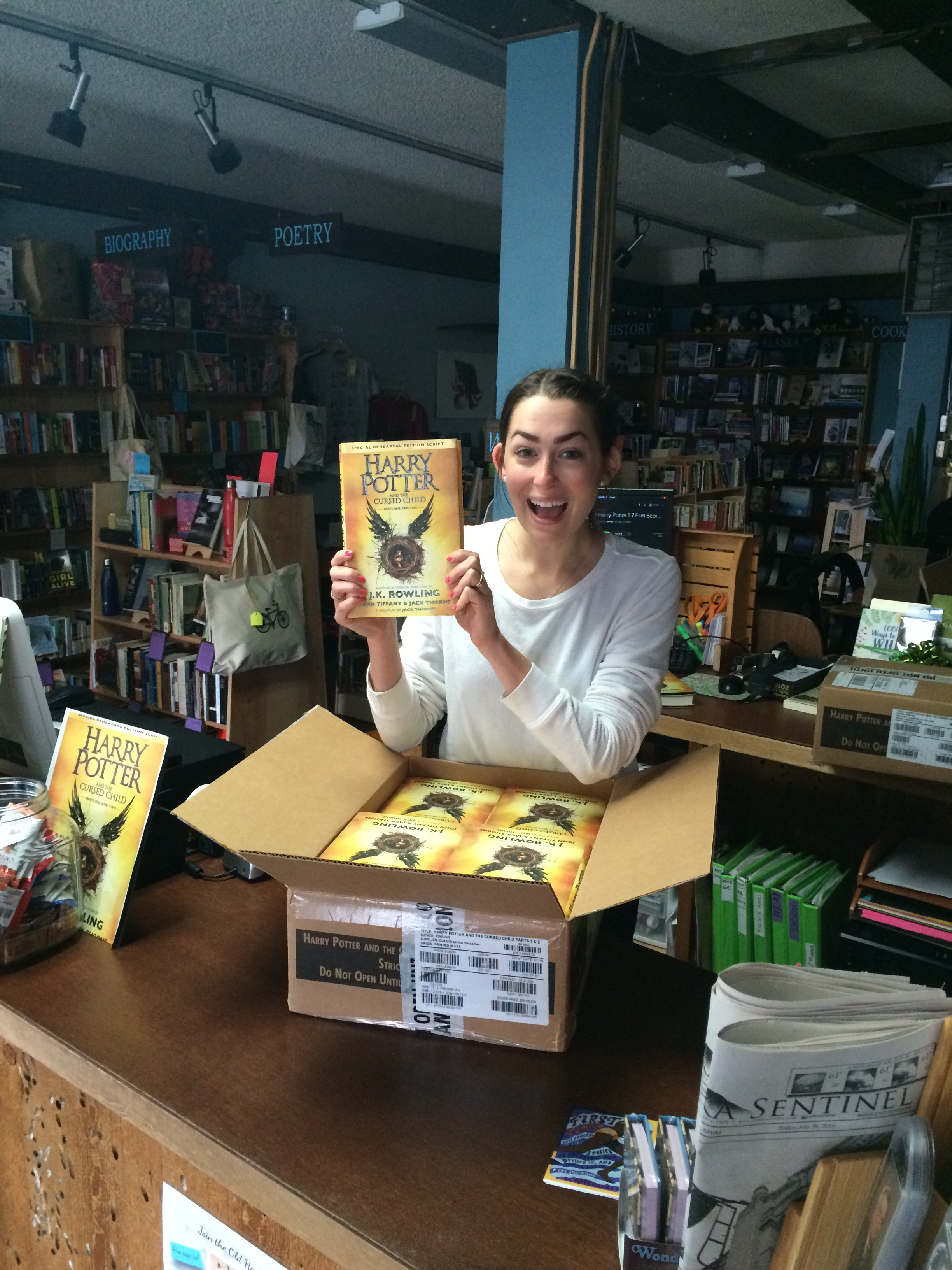 Bookseller opening crate full of copies of Harry Potter and the Cursed Child.