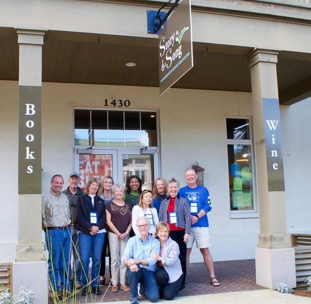 Mark and Donna Paz Kaufman, in front, are excited about their new bookstore.