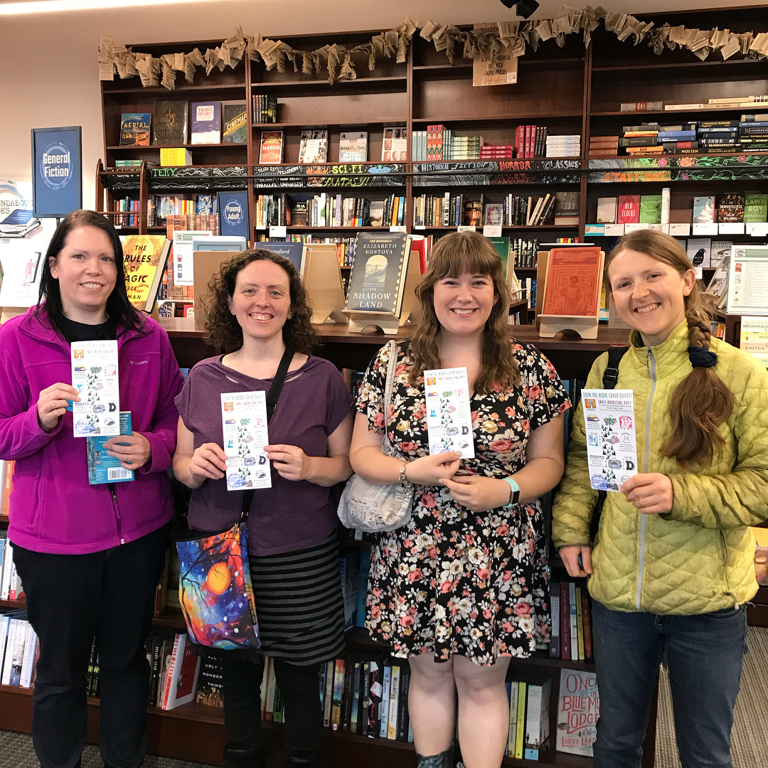 Participants in Roundabout Books' Central Oregon Book Quest show off their passports.