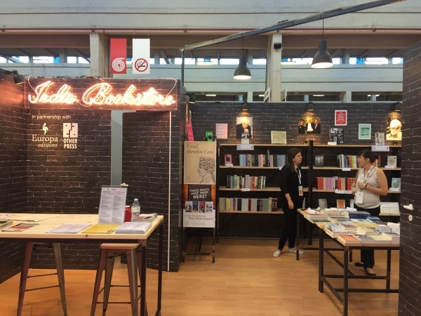 The American Indie Bookstore, with scholarship winner Camilla Orr of Changing Hands Bookstore and Clara Martinez Turco, Edizioni E/O stand assistant.