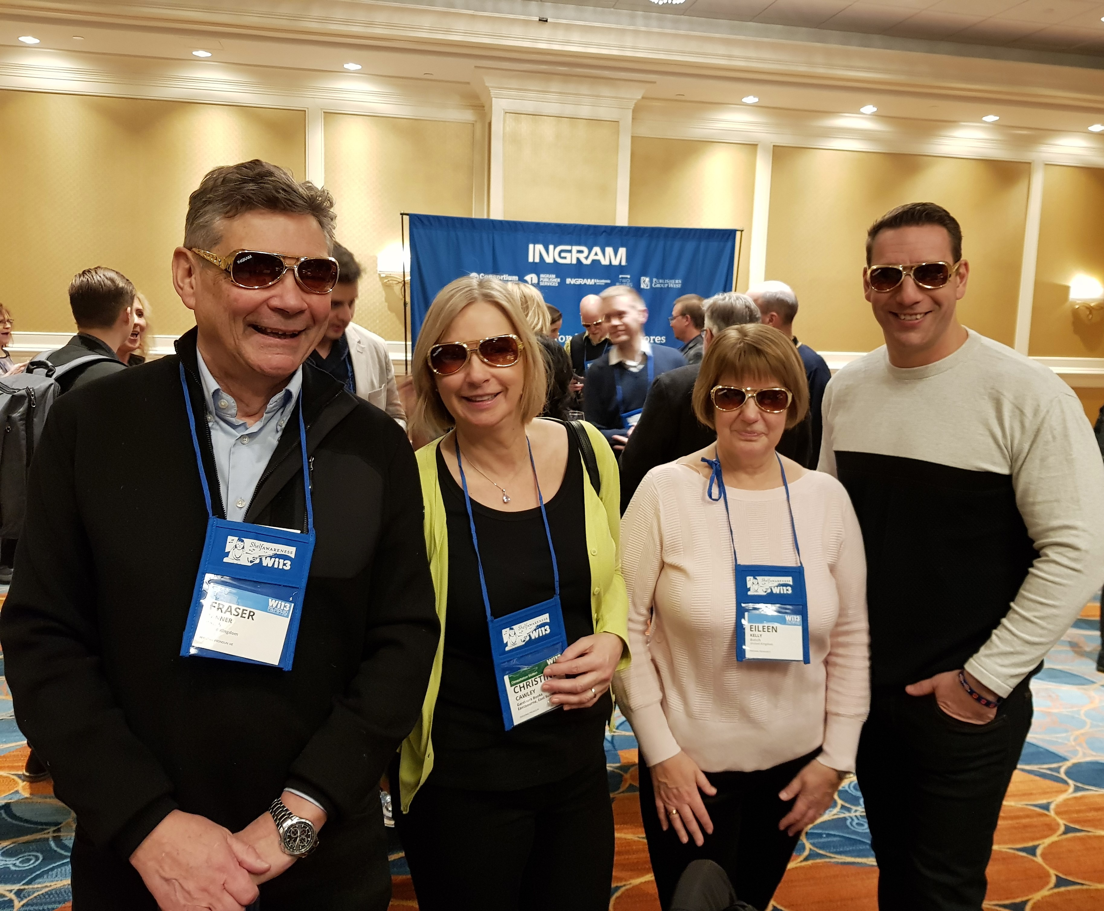 International guests enjoy their new sunglasses at the Ingram reception on Tuesday.
