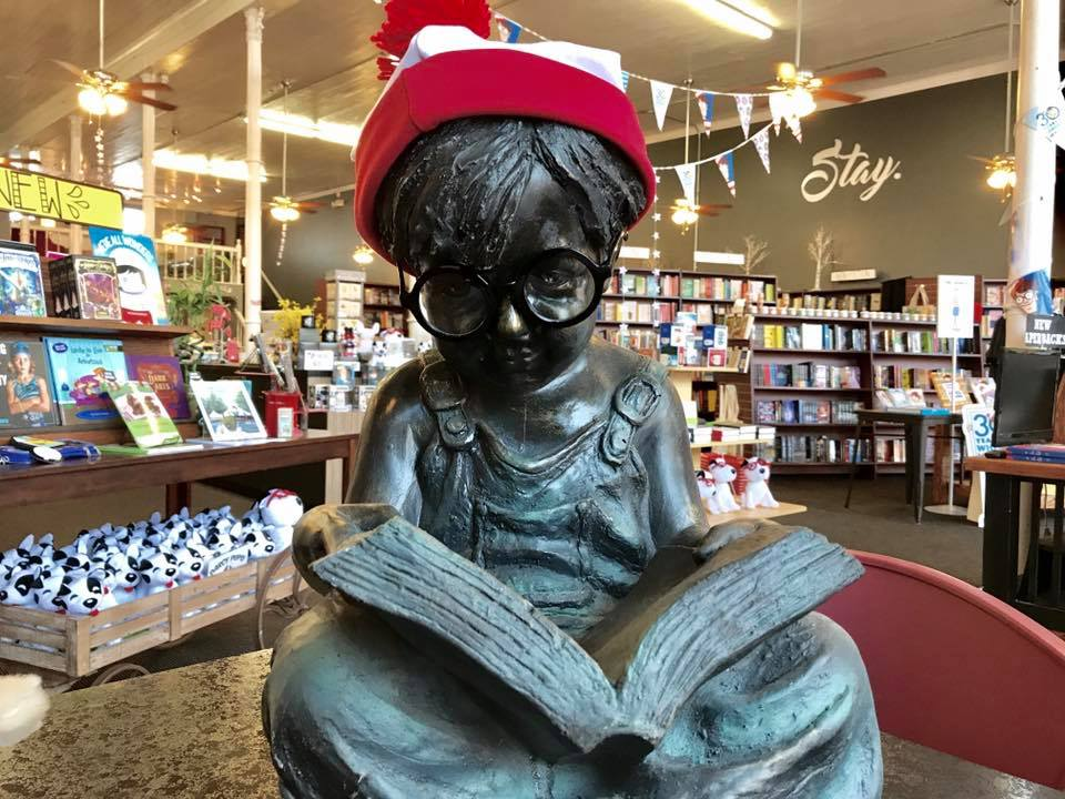 Staff at Dog Ear Books in Russellville, Arkansas even dressed their store statue, Reed, for the occasion.